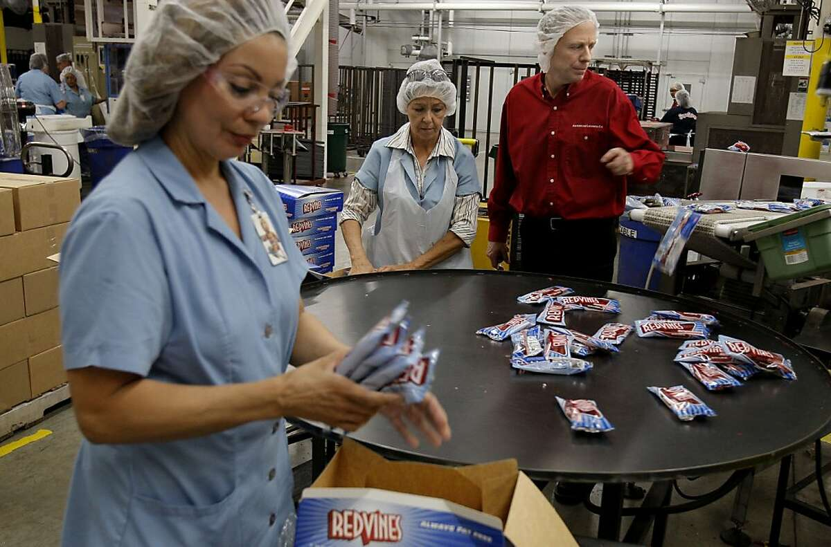 John Nelson, (center) is the plant manager of the American Licorice Company in Union City, Calif. On the production line with workers, Teresa Loza, (left) and Cenada Gamino, on Wednesday Sept. 24, 2008.