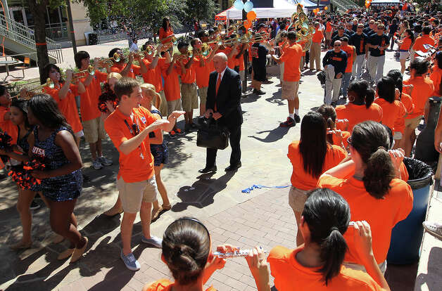 "Head football coach Larry Coker leads the football team along the UTSA main campus ""paseo"" during a rally for the football on Friday, Sept. 7, 2012. The university held their first on-campus rally for the football team on the eve of their first home game of their second season. Photo: Kin Man Hui, Express-News / ©2012 San Antonio Express-News"