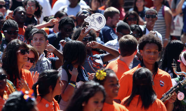 UTSA students break into an impromptu dance during a rally for the Roadrunners football team at the 1604 campus on Friday, Sept. 7, 2012. The university held their first on-campus rally for the football team on the eve of their first home game of their second season. Photo: Kin Man Hui, Express-News / ©2012 San Antonio Express-News