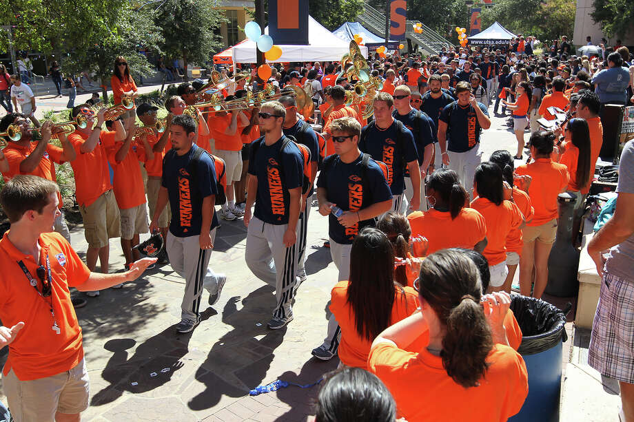UTSA football players are cheered on by students during a rally for the team at the 1604 campus on Friday, Sept. 7, 2012. The university held their first on-campus rally for the team on the eve of their first home game of their second season. Photo: Kin Man Hui, Express-News / ©2012 San Antonio Express-News