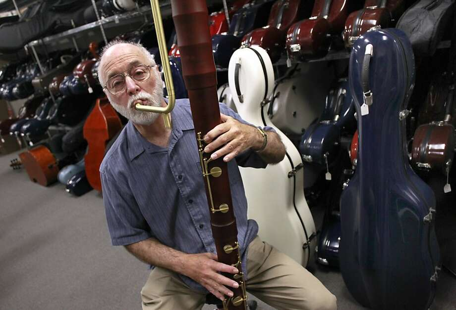 Bill Lazar plays a contrabass recorder at his Lazar's Early Music shop in Mountain View. Most of the instruments he sells are modern reproductions. Photo: Paul Chinn, The Chronicle