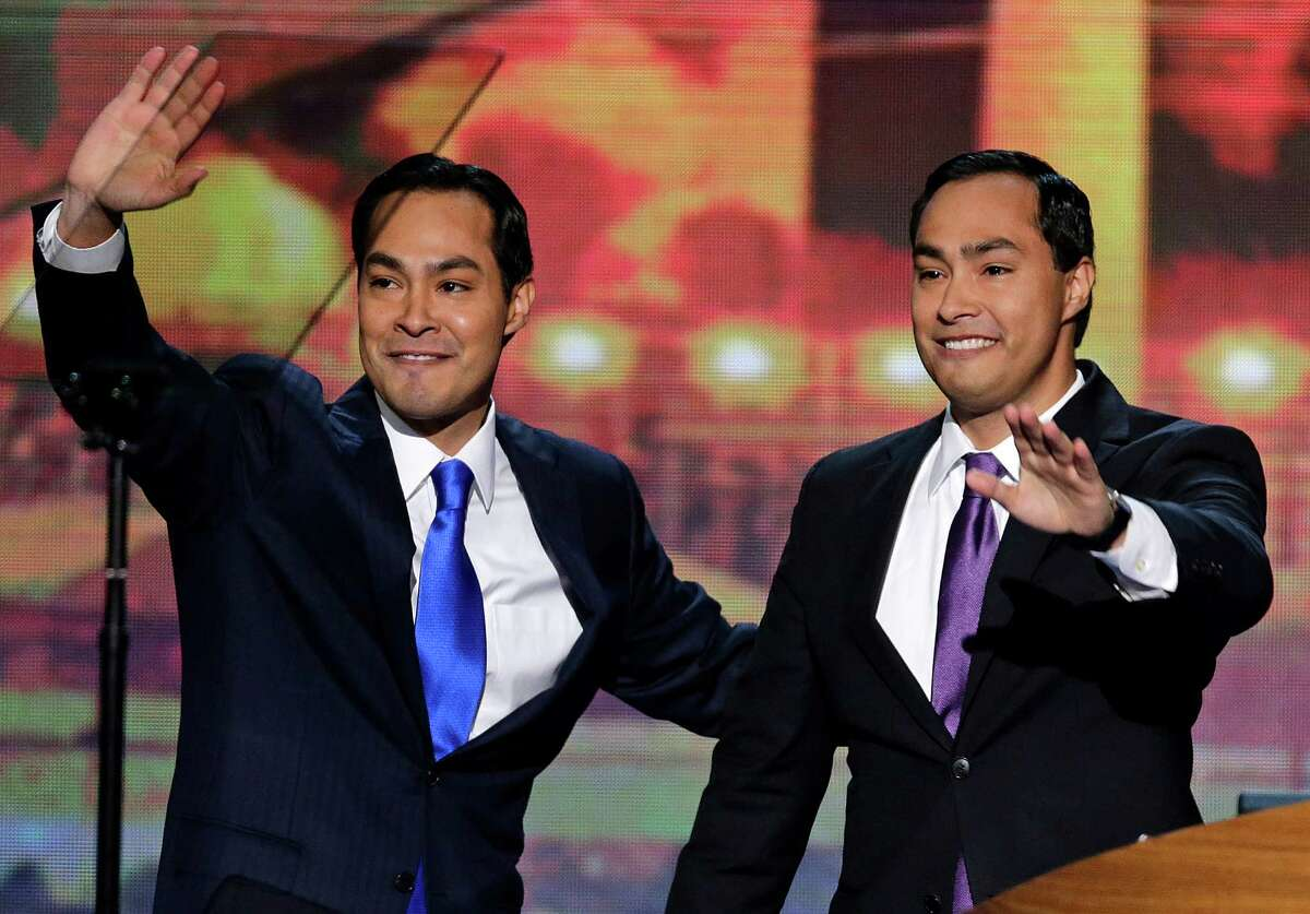 San Antonio Mayor Julian Castro and his brother Joaquin Castro, right, wave to the Democratic National Convention in Charlotte, N.C.
