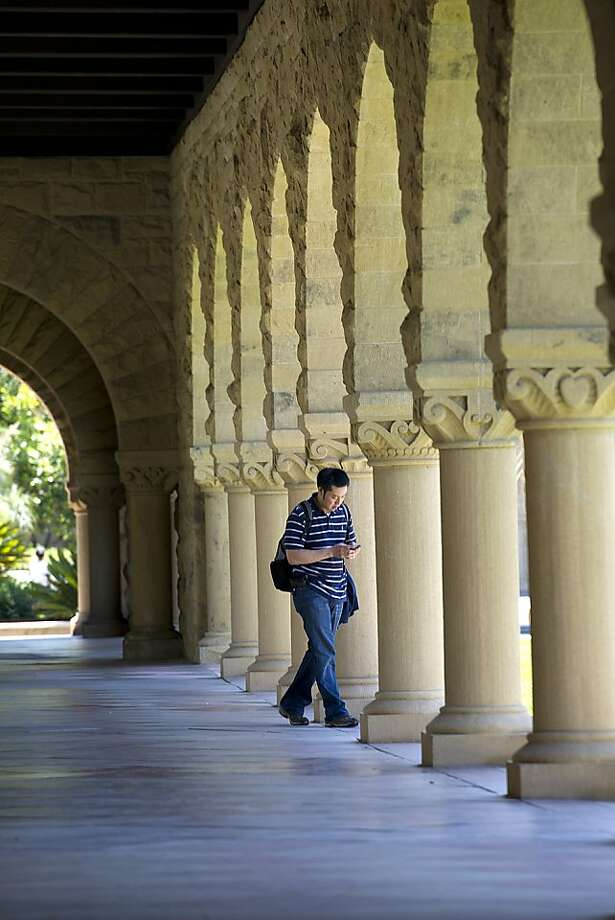 A student heads to class at Stanford University in Palo Alto, California, U.S., on Wednesday, June 8, 2011. Photo: David Paul Morris, Bloomberg