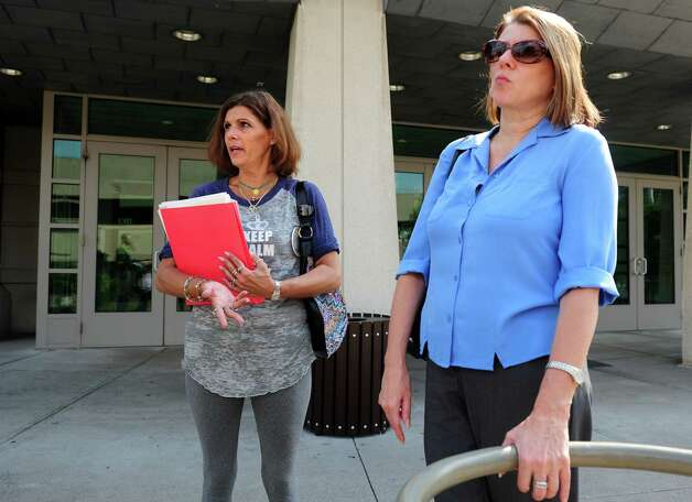 Beth Profeta, left, and Sherri Passaro, Mary Badaracco's daughters, express frustration following a hearing before the grand jury panel requesting the release of information from a grand jury proceeding about the 1984 disappearance of Mary Badaracco Friday, Sept. 7, 2012 at New Britain Superior Court. Photo: Autumn Driscoll / Connecticut Post