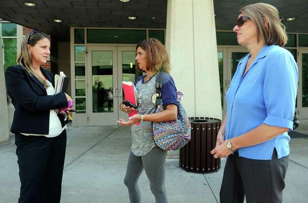 Beth Profeta, center, and Sherri Passaro, right, Mary Badaracco's daughters, talk with Michelle Cruz, the state Victims Advocate, following a hearing before the grand jury panel requesting the release of information from a grand jury proceeding about the 1984 disappearance of Mary Badaracco Friday, Sept. 7, 2012 at New Britain Superior Court. Photo: Autumn Driscoll / Connecticut Post