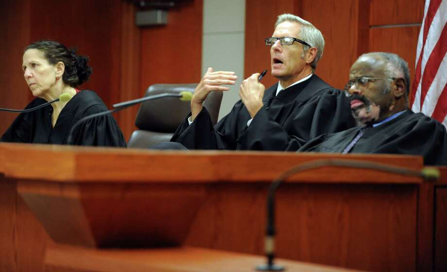 Connecticut Superior Court Judge Jon Alander, center, with Judge Hillary Strackbein, left, and Judge Carl Taylor, right, sits on a grand jury panel being asked to release information from a grand jury proceeding about the 1984 disappearance of Mary Badaracco Friday, Sept. 7, 2012 at New Britain Superior Court. Photo: Autumn Driscoll / Connecticut Post