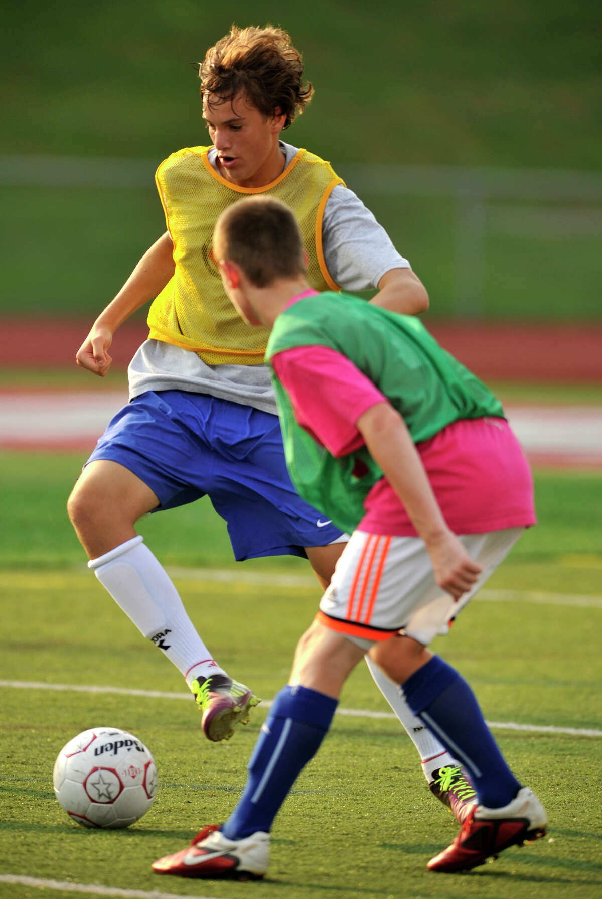 Midfielder Tyler Longo dribbles the ball during soccer practice at Pomperaug High School in Southbury on Friday, Sept. 7, 2012.