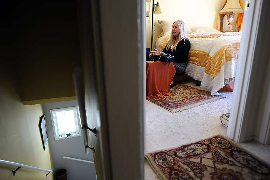Janet Sluizer says she has moved her office equipment to her bedroom because she's afraid it will be stolen by her tenant. Photo: Michael Short, Special To The Chronicle