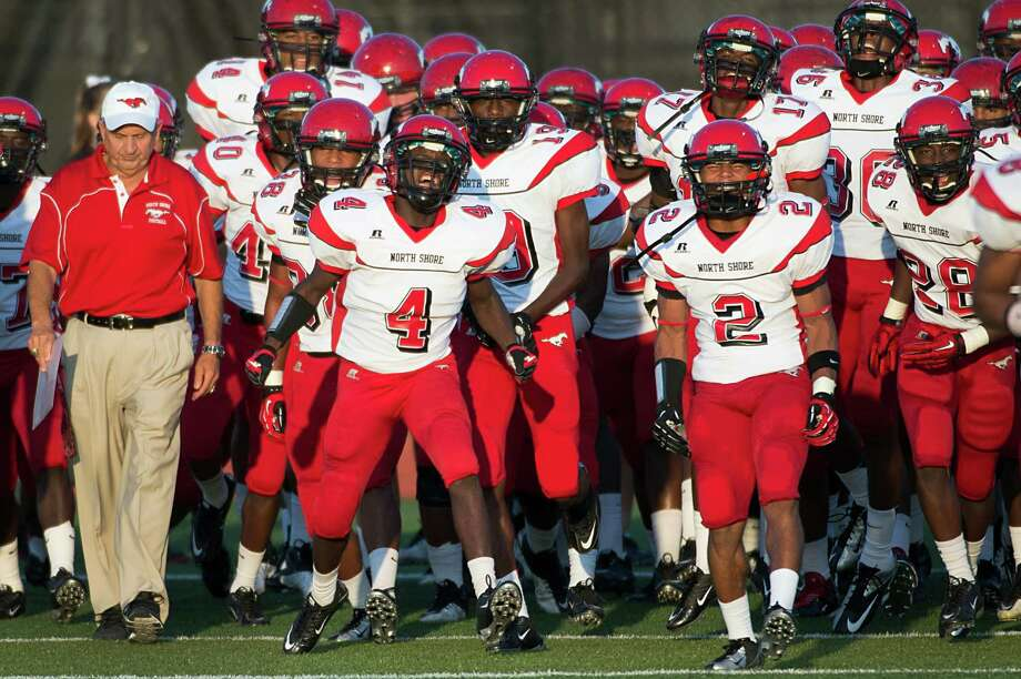 North Shore head coach David Aymond and his team take the field to face Manvel in a high school football game on Friday, Sept. 7, 2012, in Alvin. Photo: Smiley N. Pool, Houston Chronicle / © 2012  Houston Chronicle