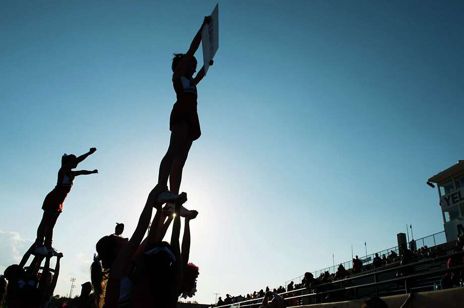 Manvel cheerleaders warm up before a high school football game against North Shore on Friday, Sept. 7, 2012, in Alvin. Photo: Smiley N. Pool, Houston Chronicle / © 2012  Houston Chronicle