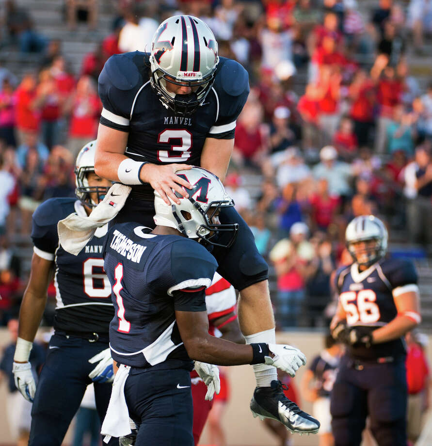 Manvel quarterback Shane McCarley (3) celebrates with receiver Carlos Thompson after the two connected on a touchdown during the first quarter of a high school football game against North Shore on Friday, Sept. 7, 2012, in Alvin. Photo: Smiley N. Pool, Houston Chronicle / © 2012  Houston Chronicle
