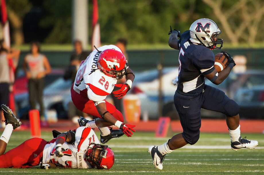 Manvel running back Richard Rose (5) races past North Shore defenders Darius Mouton (28) and Jomal Wiltz (17) for a long gain early in the first quarter of a high school football game on Friday, Sept. 7, 2012, in Alvin. Photo: Smiley N. Pool, Houston Chronicle / © 2012  Houston Chronicle