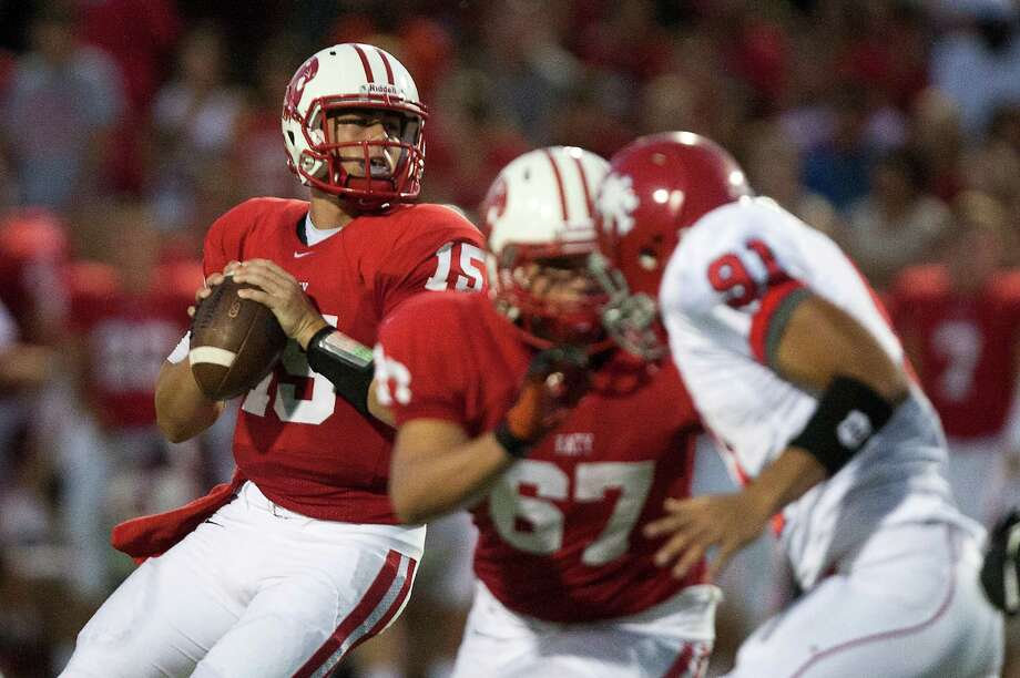Katy quarterback Kiley Huddleston (15) looks for an open man during the first half against Alief Taylor at Rhodes Stadium on Friday, Sept. 7, 2012, in Katy. Photo: J. Patric Schneider, For The Chronicle / © 2012 Houston Chronicle