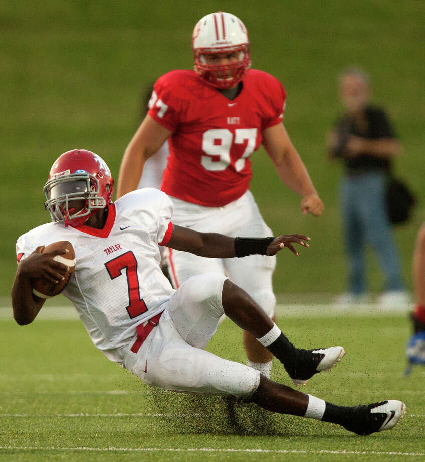 Alief Taylor quarterback Remi Olonade (7) loses his footing against the Katy Tigers during the first half at Rhodes Stadium on Friday, Sept. 7, 2012, in Katy. Photo: J. Patric Schneider, For The Chronicle / © 2012 Houston Chronicle