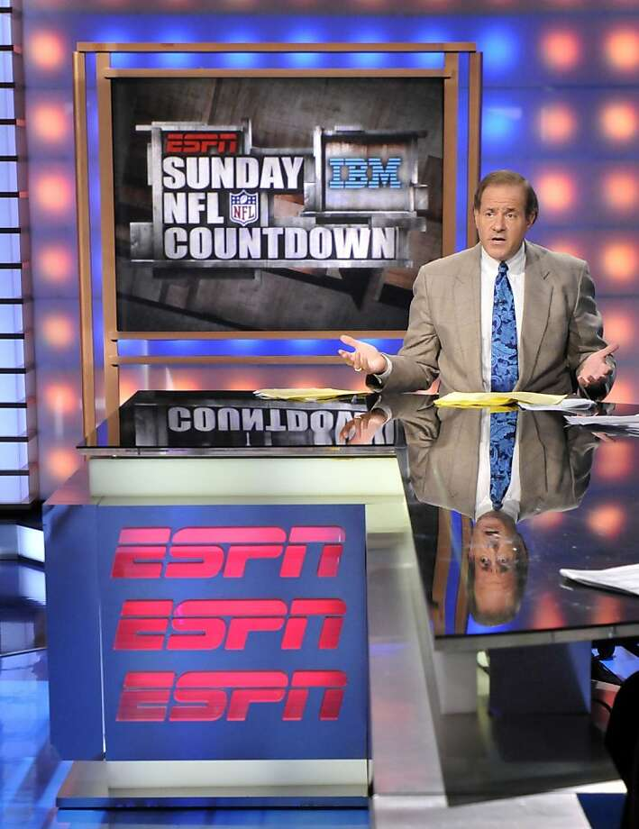 Chris Berman gestures while doing a live segment of Sunday NFL Countdown at ESPN in Bristol, Conn., Sunday, Oct. 26, 2008.  Hired by ESPN nearly 30 years ago from his job anchoring weekend sports on local television, Berman has helped change how sports fans get their news and how sportscasters approach their work.  (AP Photo/Jessica Hill) Photo: Jessica Hill, AP