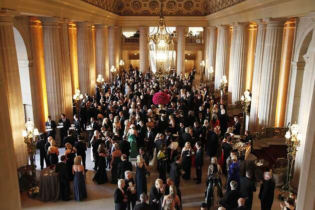 Opera patrons mingle at the Opera Ball celebrating the opening of the San Francisco Opera's 90th Season on Friday, Sept. 7, 2012. After cocktail hour those in attendance were entertained with Giuseppe Verdi's Rigoletto conducted by Music Director Nicola Luisotti. Photo: Alex Washburn