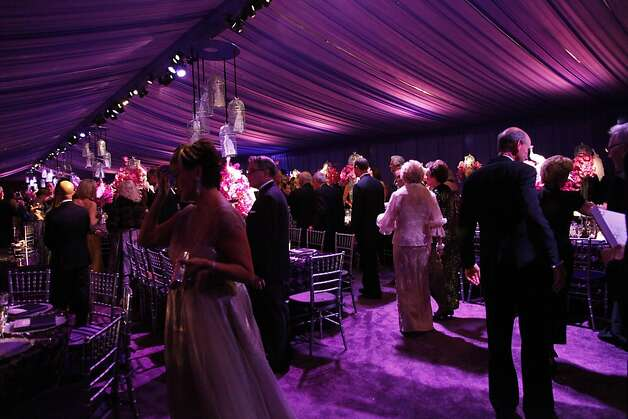 Opera patrons find their seats for dinner at the Opera Ball celebrating the opening of the San Francisco Opera's 90th Season on Friday, Sept. 7, 2012. After cocktail hour those in attendance were entertained with Giuseppe Verdi's Rigoletto conducted by Music Director Nicola Luisotti. Photo: Alex Washburn