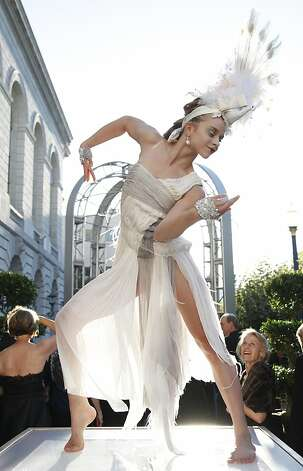 A performer delights guests on their way to dinner at the Opera Ball celebrating the opening of the San Francisco Opera's 90th Season on Friday, Sept. 7, 2012. After cocktail hour those in attendance were entertained with Giuseppe Verdi's Rigoletto conducted by Music Director Nicola Luisotti. Photo: Alex Washburn