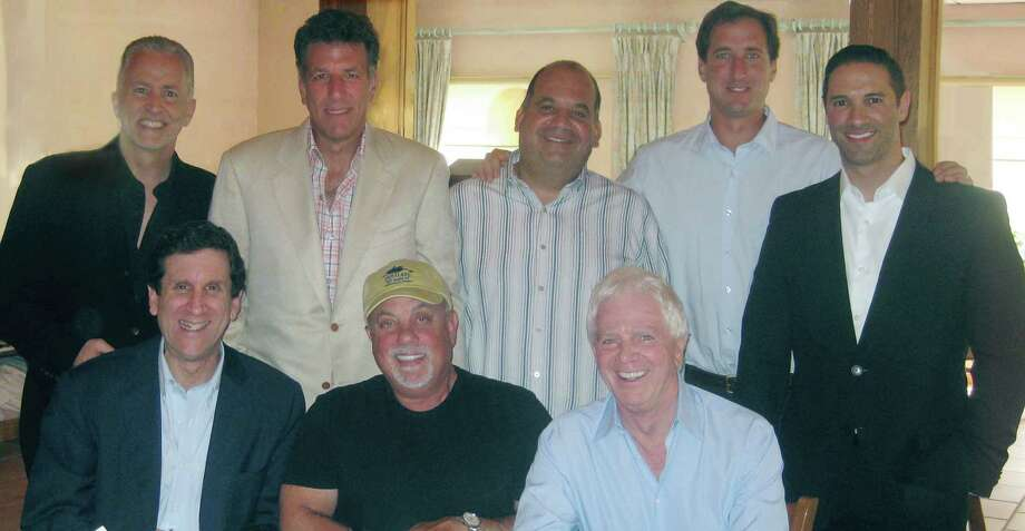 Billy Joel, front row, second from left, and Greenwich resident Don Ienner, back row, second from left, with music execs after Joel signed an exclusive worldwide publishing administration agreement with Rondor Music and Universal Music Publishing Group Worldwide. Pictured, front row, from left: Zach Horowitz, Chairman and CEO, UMPG Worldwide; Billy Joel; Lance Freed, president of Rondor Music; back row, from left: Michael J. Sammis, EVP of operations and CFO Worldwide, UMPG; Don Ienner, consultant; Todd Kamelhar, of Gelfand, Rennert & Feldman; Lee Eastman, of Eastman & Eastman; David Kokakis, SVP/Head of Business Affairs/Business Development, UMPG. Photo: Contributed Photo / Greenwich Time Contributed