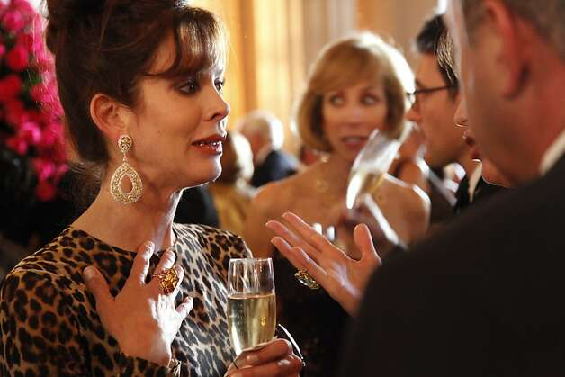 Stephanie Ejabat talks with friends at the Opera Ball celebrating the opening of the San Francisco Opera's 90th Season on Friday, Sept. 7, 2012. After cocktail hour those in attendance were entertained with Giuseppe Verdi's Rigoletto conducted by Music Director Nicola Luisotti. Photo: Alex Washburn