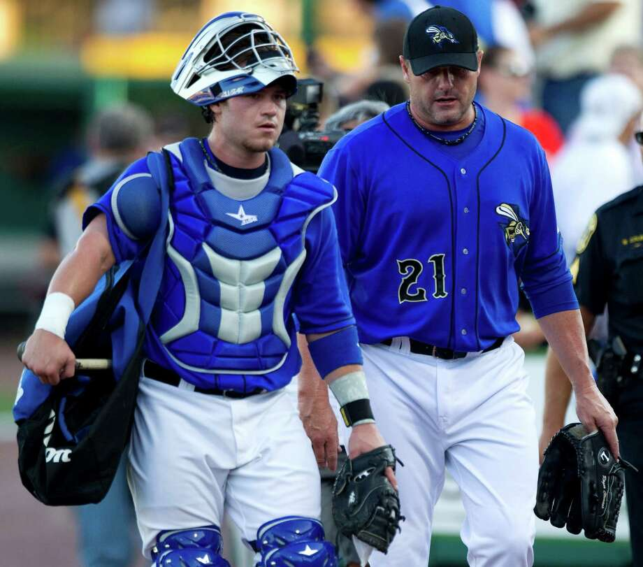 Sugar Land Skeeters catcher Koby Clemens, left, and his father, starting pitcher Roger Clemens walk in from the bullpen before a minor league baseball game against the Long Island Ducks at Constellation Field Friday, Sept. 7, 2012, in Sugar Land. Photo: Brett Coomer, Chronicle / © 2012 Houston Chronicle