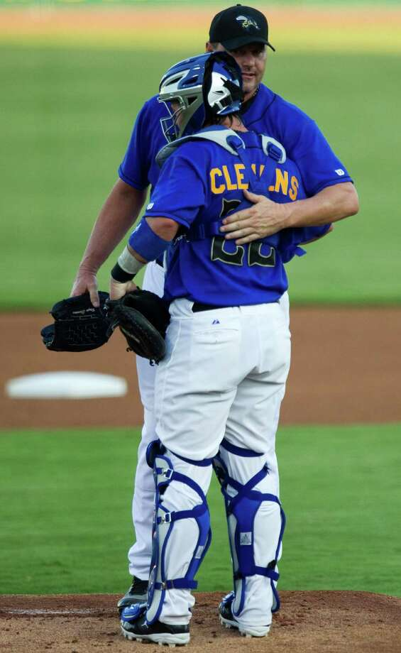 Sugar Land Skeeters starter Roger Clemens embraces his son, catcher Koby Clemens (22) before his second outing for the Skeeters in a minor league baseball game against the Long Island Ducks at Constellation Field Friday, Sept. 7, 2012, in Sugar Land. Photo: Brett Coomer, Chronicle / © 2012 Houston Chronicle