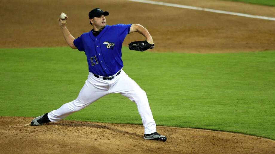 Sugar Land Skeeters starter Roger Clemens throws a split finger fastball during the third inning against the Long Island Ducks in a minor league baseball game at Constellation Field Friday, Sept. 7, 2012, in Sugar Land. Photo: Brett Coomer, Chronicle / © 2012 Houston Chronicle