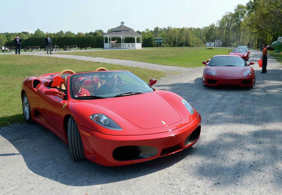 A small grouping of Ferraris arrive at the Saratoga Polo field in Saratoga Springs, N.Y. for the Saratoga Wine & Food and Fall Ferrari Festival benefiting the Saratoga Performing Arts Center Sept. 7, 2012. (Skip Dickstein/Times Union)