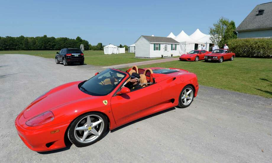 A small grouping of Ferraris arrive at the Saratoga Polo field in Saratoga Springs, N.Y.  for the Saratoga Wine & Food and Fall Ferrari Festival benefiting the Saratoga Performing Arts Center Sept. 7, 2012.    (Skip Dickstein/Times Union) Photo: Skip Dickstein / 00019153A
