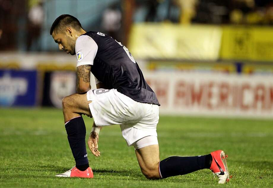 American Clint Dempsey is brought to a knee after Jamaica scores. Photo: Marc Serota, Getty Images