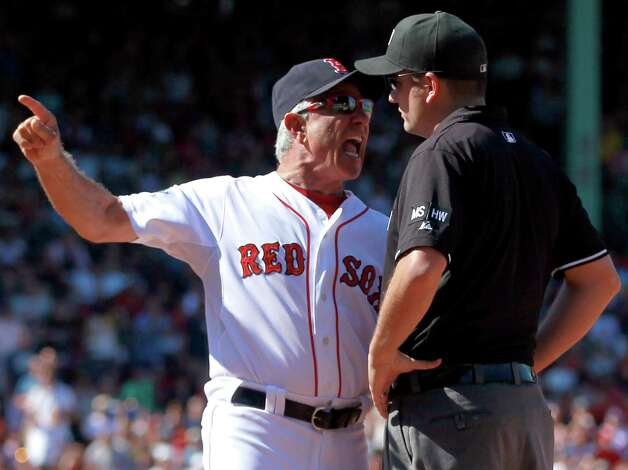 Boston Red Sox manager Bobby Valentine, left, argues a call with first base umpire Dan Bellino, right, after Red Sox's Dustin Pedroia was called out at first base in the fifth inning of a baseball game against the Kansas City Royals at Fenway Park in Boston, Sunday, Aug. 26, 2012. Valentine was thrown out of the game. (AP Photo/Steven Senne) Photo: Steven Senne, Associated Press / AP