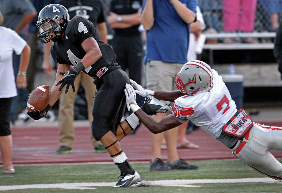 Knight running back Justin Stockton is pushed out of bounds at the 1 yard line by Tre Flowers after a long run as Steele hosts Judson at Lehnhoff Stadium on September 7, 2012. Photo: Tom Reel, Express-News / ©2012 San Antono Express-News