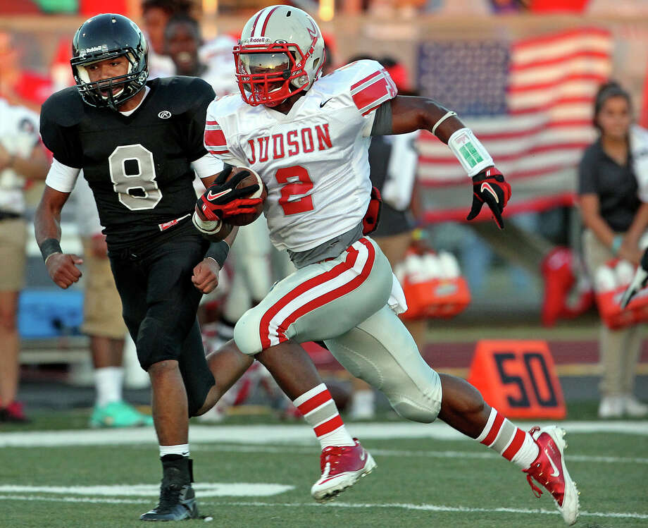 Jarveon Williams shows Judson means business as he breaks away on a long run with Knight defender Jorn Burton trying to keep up as Steele hosts Judson at Lehnhoff Stadium on September 7, 2012. Photo: Tom Reel, Express-News / ©2012 San Antono Express-News