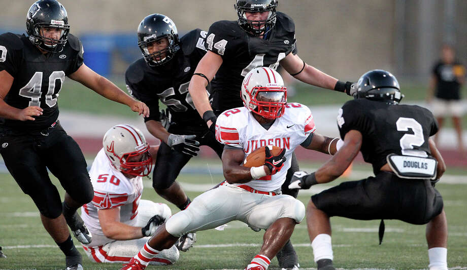 Judson running back Jarveon Williams shifts laterally under a wall of Knight defenders as  Steele hosts Judson at Lehnhoff Stadium on September 7, 2012. Photo: Tom Reel, Express-News / ©2012 San Antono Express-News