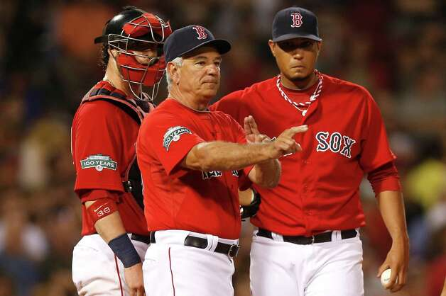 BOSTON, MA - SEPTEMBER 7:  Manager Bobby Valentine #25 of the Boston Red Sox signals to the bullpen removing pitcher Felix Doubront #61 of the Boston Red Sox, right, from the game as catcher Jarrod Saltalamacchia #39 of the Boston Red Sox looks on during the fourth inning of the game against the Toronto Blue Jays at Fenway Park on September 7, 2012 in Boston, Massachusetts.  (Photo by Winslow Townson/Getty Images) Photo: Winslow Townson, Getty Images / 2012 Getty Images