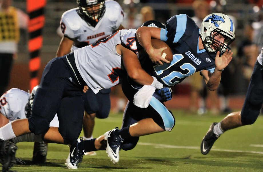 Johnson quarterback Hunter Rittiman is tackled bt Brandeis' Isaac Gorman. Photo: ROBIN JERSTAD  ROBIN@JERSTADPHOT, Express-News