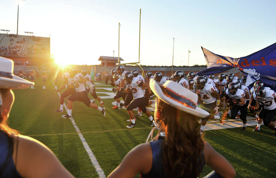 The Brandeis High School football team takes the field versus Johnson Friday night at Heroes Stadium. Photo: ROBIN JERSTAD  ROBIN@JERSTADPHOT, Express-News