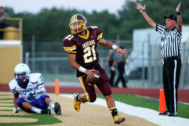 The official signals touchdown as Harlandale's Nicholas Martinez scores a touchdown during their game with Lanier at Harlandale Memorial Stadium on Sept. 7, 2012.  Harlandale won the game 58-16.  MARVIN PFEIFFER/ mpfeiffer@express-news.net Photo: MARVIN PFEIFFER, Express-News / Express-News 2012