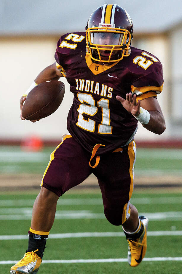 Harlandale running back Nicholas Martinez looks for running room during their game with Lanier at Harlandale Memorial Stadium on Sept. 7, 2012.  MARVIN PFEIFFER/ mpfeiffer@express-news.net Photo: MARVIN PFEIFFER, Express-News / Express-News 2012