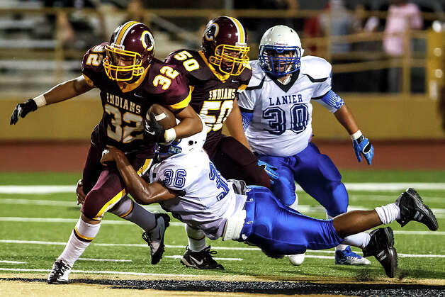 Lanier's Isaac Garcia brings down Harlandale wide receiver Jonathan Rodriguez during their game at Harlandale Memorial Stadium on Sept. 7, 2012.  Harlandale won the game 58-16.  MARVIN PFEIFFER/ mpfeiffer@express-news.net Photo: MARVIN PFEIFFER, Express-News / Express-News 2012