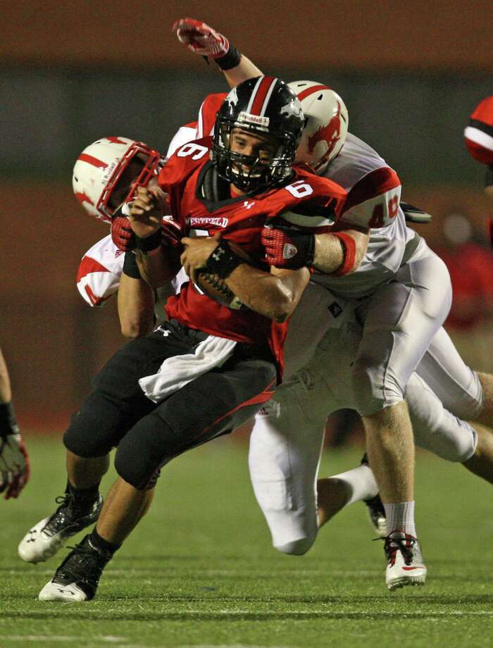 Westfield quarterback William Dedon (6) is tackled by Memorial's Tug White (49) and Stephen Gugenheim during the first half of a high school football game, Friday, September 7, 2012 at George Stadium in Spring, TX. Photo: Eric Christian Smith, For The Chronicle