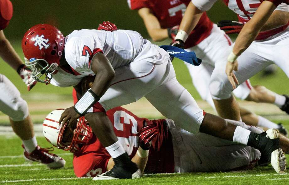 Alief Taylor quarterback Remi Olonade (7) is brought down by Katy linebacker Cole Barry (43) during the fourth quarter at Rhodes Stadium on Friday, Sept. 7, 2012, in Katy. Photo: J. Patric Schneider, For The Chronicle / © 2012 Houston Chronicle