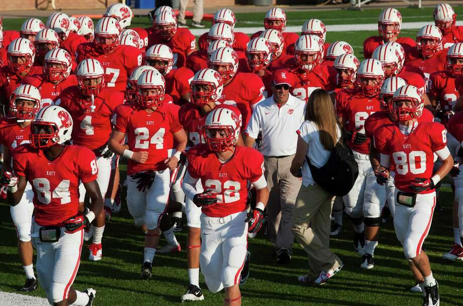 Head football coach Gary Joseph (white shirt) and the Katy Tiger football team walk off the field after warm ups as they prepare to face Alief Taylor at Rhodes Stadium on Friday, Sept. 7, 2012, in Katy. Photo: J. Patric Schneider, For The Chronicle / © 2012 Houston Chronicle