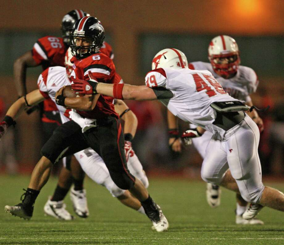 Westfield quarterback William Dedon (6) is tackled by Memorial's Tug White (49) during the first half of a high school football game, Friday, September 7, 2012 at George Stadium in Spring, TX. Photo: Eric Christian Smith, For The Chronicle