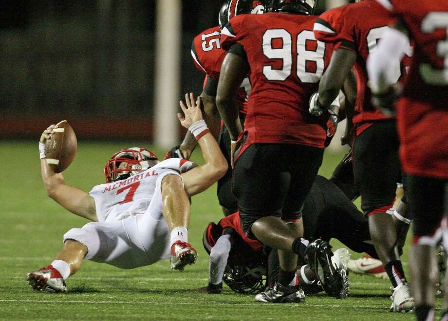 On fourth-and-twelve, Memorial quarterback Tyler McCloskey (7) stretches to convert a first down during the second half of a high school football game against Westfield, Friday, September 7, 2012 at George Stadium in Spring, TX. Photo: Eric Christian Smith, For The Chronicle