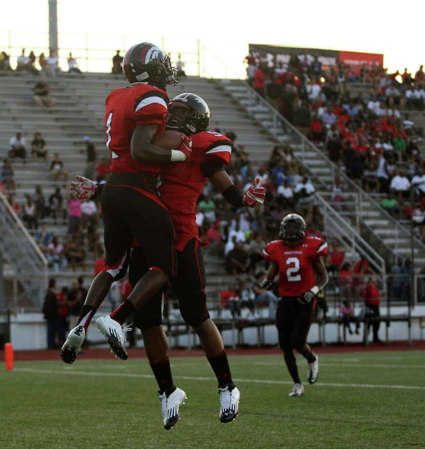 Westfield's Tevin Lewis (left) celebrates his 37-yard touchdown reception with Will Sikora during the first half of a high school football game with Memorial, Friday, September 7, 2012 at George Stadium in Spring, TX. Photo: Eric Christian Smith, For The Chronicle