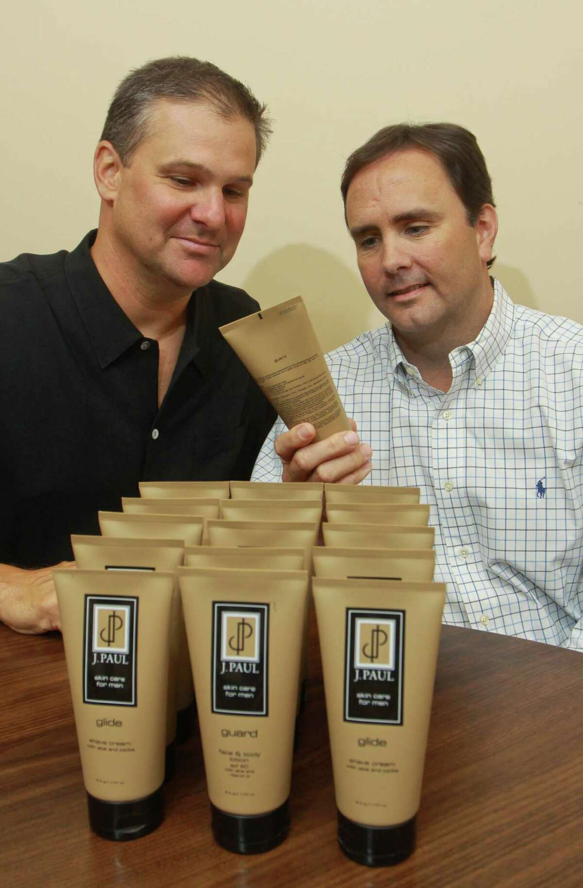 (For the Chronicle/Gary Fountain, September 4, 2012) Paul Strong, left, and Paul Looney, owners of J. Paul Skincare, with items from their product line. J. Paul Skincare is a skincare line for men.