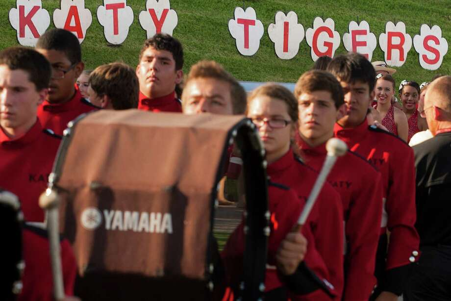 The Katy Tiger band marches in as the football team prepares to face off against Alief Taylor at Rhodes Stadium on Friday, Sept. 7, 2012, in Katy. Photo: J. Patric Schneider, For The Chronicle / © 2012 Houston Chronicle