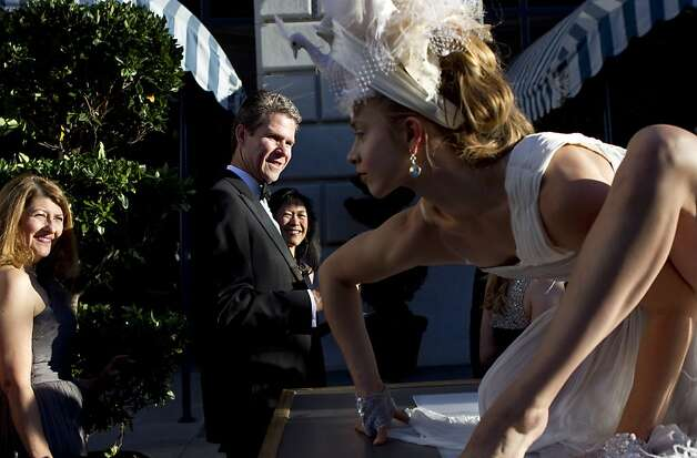 Haley Viloria (right) performs for guests of the San Francisco Opera Opening Night Gala as they walk to dinner outside the War Memorial Opera House in San Francisco, Calf., on Friday, September 7, 2012. Photo: Laura Morton, Special To The Chronicle