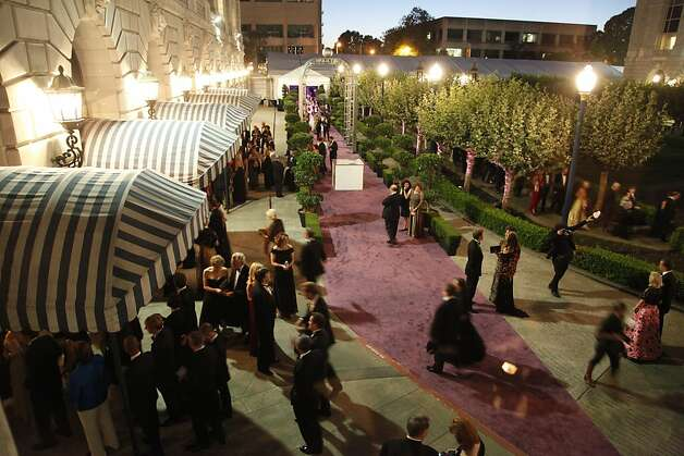 Opera patrons enter The War Memorial Opera House for the opening of the San Francisco Opera's 90th Season on Friday, Sept. 7, 2012. Those in attendance were entertained with Giuseppe Verdi's Rigoletto conducted by Music Director Nicola Luisotti. Photo: Alex Washburn